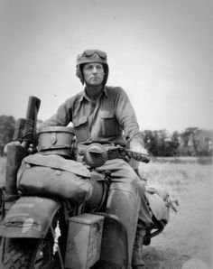 Messenger Private Robert Vance (Robert J Vance) of the 33 th Tank Regiment 3rd Armored Division United States on a motorcycle Harley Davidson WLA Liberator.