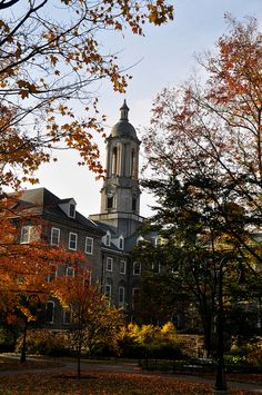 penn state campus old main bright red foliage in the  old main building during autumn at my alma mater penn state