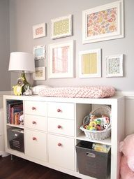 Framing pieces of fabric is an inexpensive way to make art for childrens rooms. Here, a range of frames were collected from thrift stores and then spray painted white.  The nursery dresser is also an ingenious DIY projects - a converted IKEA Expedit bookcase, with drawers, legs and new knobs.