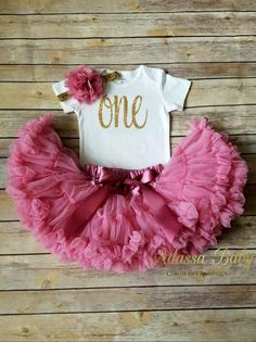 Show your little princess off in this oh so glam dusty rose and gold first birthday outfit. - This is listing includes flower headband, bodysuit and dusty rose pettiskirt as seen in photo. - Perfect f