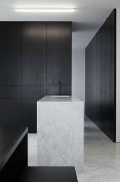 White marble kitchen inside an apartment in Antwerp by Stein van Rossem.