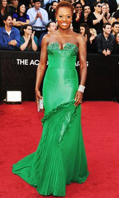 """Vera Wang designed Best Actress nominee Viola Davis's strapless green gown, which featured a pleated skirt detail and embroidered neckline. """"She did right by me,"""" The Help star graciously said of the designer."""