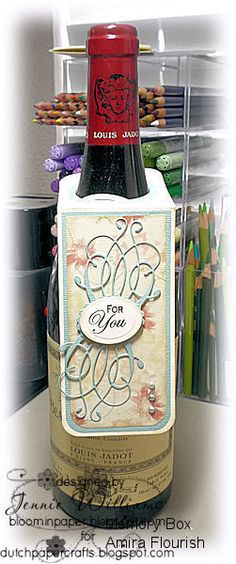 1/16/2012; Jennie Williams at 'Bloomin' Paper' blog using the Amira flours die from Memory Box for the wine bottle tag