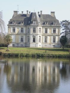 """French chateau. French country house exterior facade."" Like from Disney's Aristocats."