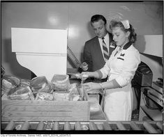 A female employee wrapping meat at a Dominion grocery store in Toronto, Ontario. Working Girls, Old Country Stores, Canadian History, Butcher Shop, Retail Stores, Toronto Canada, Time Capsule, Grocery Store, Fence