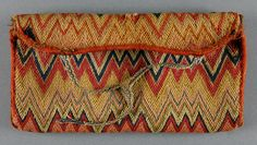 Pocketbook, mid to late 18th c. 3 15/16 x 7 1/2 in. Wool on linen with wool lining and wool binding. Accession no 1930-30-19, Philadelphia Museum of Art.