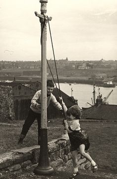 This picture again from the Newcastle Libraries flickr set shows two children like the brother and sister in the play, playing in North Shields in the early 1960s. The view of South Shields across the river still has many features visible today.