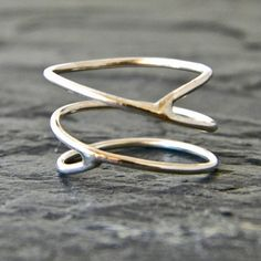 This is a unique, beautiful ring with a light criss cross design. Ive handcrafted it of 18 gauge sterling silver wire and soldered it so