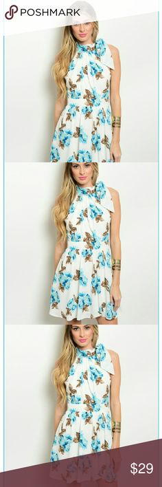 Floral Dress Classy tie around the neck white dress with blue green flowers. Peek a boo opening in the back. Clinched waist with a side zipper. Dresses Strapless