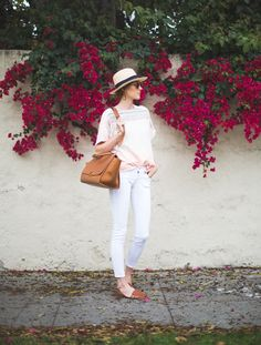 white jeans, flowing shirt, hat