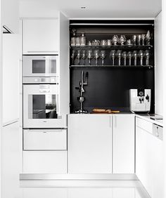 Aamiaiskaappi white kitchen, large upper cabinet with small appliance garage - white appliances for the win Compact Kitchen, New Kitchen, Mini Kitchen, Kitchen Black, Contemporary Kitchen Furniture, Small White Kitchens, Small Home Offices, Traditional Bedroom Decor, Tiny House Design