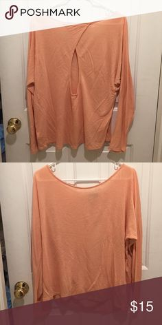 Long sleeve shirt Salmon colored long sleeve top with open slit back. Perfect lounge shirt..great condition/ only worn once Forever 21 Tops Tees - Long Sleeve