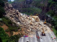 In 2004 Malaysia suffered the latest in a series of landslide incidents when a large rockslope failed and collapsed onto the New Klang Valley Expressway (NKVE) on the edge of Kuala Lumpur at Bukit Lanjan.  This remarkable landslide, pictured below, closed the motorway for many months,inducing huge costs, although fortunately no-one was killed:  LRSLIDE26