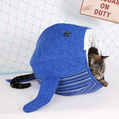 We have redesigned our Cat Ball® cat bed to be a whale! What cat doesn't want to sit inside the belly of a whale while taking a nap? Our shark Cat Ball® cat bed has been such a success that we wanted