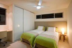 Modern wardrobe design to make a small bedroom look bigger