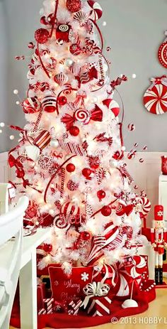 Christmas Tree ● Candy Cane I did this for yrs when we had two white Christmas Trees one was candy cane and the other (which we have now) is a white tree white lights and done in sliver and all shades of blue silver white. Noel Christmas, Primitive Christmas, Winter Christmas, Candy Cane Christmas Tree, White Christmas Tree With Red, Country Christmas, Christmas Stuff, Deco Table Noel, Beautiful Christmas Trees