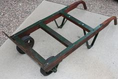 Industrial Shop Cart / Dolly Hand Truck.  It would make a cool steampunkish coffee table.