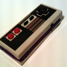Hey, I found this really awesome Etsy listing at http://www.etsy.com/listing/105452212/video-game-controller-zippered-wallet-in
