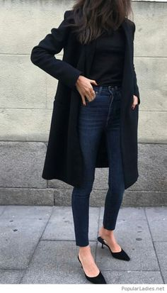 Dark jeans with a blouse and a coat