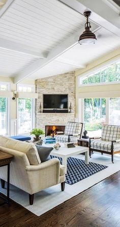 #homedesign #livingroomdecor #inspiration | Mid-sized traditional formal open concept living room in New York with dark hardwood floors, a corner fireplace, a stone fireplace surround, a wall-mounted tv and beige walls. — Houzz