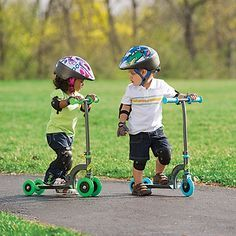 playing kick scooters