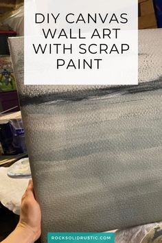 If you have an outdated canvas then this is a quick way to make your own DIY canvas painting. Using textured wallpaper and scrap paint, you can make DIY canvas art to match your home decor.