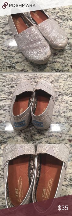 Silver glitter toms Used super cute good condition.  Some of glitter worn off toes but still looks adorable Toms Shoes