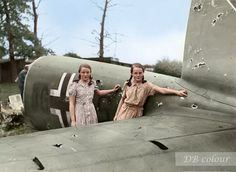 "11 year old Cousins, Wendy Anderton and Cathie Jones pose with the tail section of a Heinkel He 111P-2 of 8./KG27 which crashed landed by their home at Border House Farm near Chester in Cheshire, August 14, 1940. The five crew survived and were taken prisoner and the 'kill' was claimed by the Spitfire of P/O P. Ayerst, Nº 7 OTU. ""It occurred at approx. 1930 hrs, weather good, 14/08/40. Peter Ayerst, Hallings-Pott & McLean all heard explosions and saw an (only one) aircraft ""5 miles away""…"