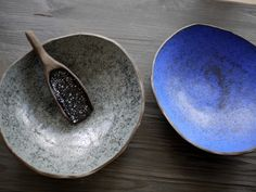 Two ceramic bowls that can be interpreted as cosmos, galaxy thanks to its navy blue colour on the first and black dots on grey on the second one. Gift ideas for someone who appreciates handmade ceramic. - by Projectorium design studio from Poland.