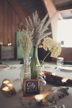 Love the driftwood, candles and unique florals!  Photography By / http://brookecourtney.com