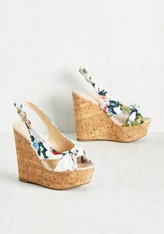 Height-Hearted Wedge in Floral. Life is all about perspective, and wearing these cork-inspired wedges, youll have the best view around! #white #modcloth