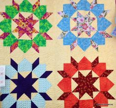 Swoon by Thimble Blossoms. Love the pale yellow background and the Baptist Fan quilting!