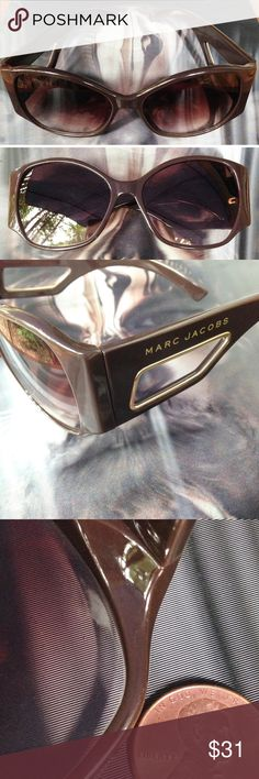 *SALE* Marc Jacobs Daisy Sunglasses in Brown So haute!! Rare vintage Marc Jacobs wrap around sunglasses in brown. Plastic frames with gold brand name & detailing on unique cut out sides. Brown gradient lenses. Lovingly used, some light scratches on lenses, see photo for detail of inner right lens for wear from when folded - not seen when worn. Great vintage condition. Lens width 55 mm, bridge width 16 mm, temple/arm length 130 mm. Chic!  HP Top Trends Apr 1 2016  Total Trendsetter July 6…