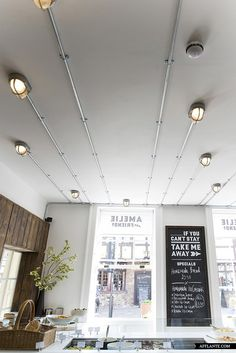 GREAT way to add ceiling lights withough seeing cords, dealing with sheet rock, or doing pendant lights!  Love!  (Amelie and Friends Restaurant)