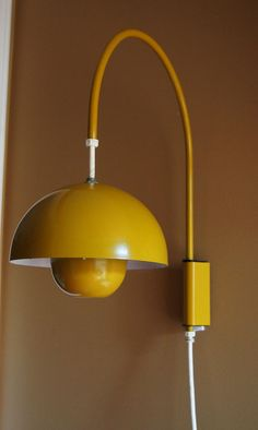 "The yellow coloured wall lamp ""Enamel Flower Pot"" designed by the Verner Panton from Lamp Design, Lighting Design, Lampe Spot, Plug In Wall Sconce, Exterior Light Fixtures, Wood Floor Lamp, Mid Century Lighting, Mid Century Modern Furniture, Lamp Light"