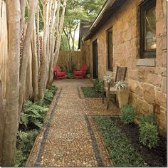 "Wonderful paved side path with contrasting stone borders! Also like the crepe myrtle ornamental trees hiding the fence on the left. Thanks to Joni Webb of Cote de Texas for this image! Click through to view blog posting about ""disappearing views""."