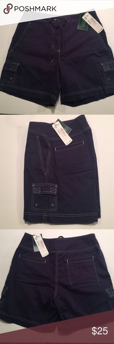 """Lauren Ralph Lauren Navy Cotton Short size 7 Navy baggy cargo short with white top stitching.  Zip fly with button closure and nautical rope tie detail.  Item is BNWT's, never worn condition.  Size 6 - waist 28"""", hips 40"""", inseam6"""" and overall length is 17"""". Lauren Shorts"""