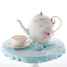 Mother's Day hightea teapot & teacup cake, delicately decorated in pink & blue with gold accents. The teapot is filled with yummy citrus white mud layered with matching white ganache. Every single detail is edible.