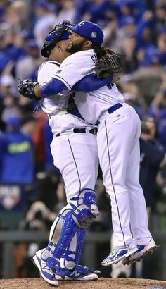 Kansas City Royals catcher Salvador Perez gives Kansas City Royals starting pitcher Johnny Cueto a big hug after Cueto pitched a complete two-hit game to defeat the New York Mets 7-1 in game two of the World Series on Wednesday, October 28, 2015 at Kauffman Stadium in Kansas City, Mo.