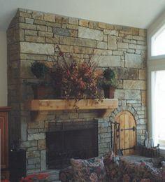 Stone Brick Fireplace - Love the little wooden door!