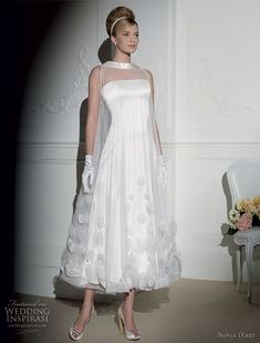 Novia D'art wedding dress 2011 bridal collection - retro funnel neck wedding gown with floral, worn with wrist gloves