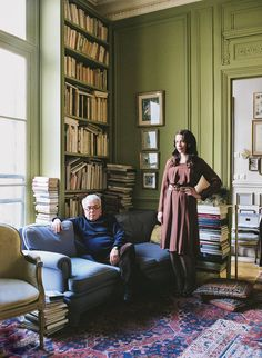 The illustrator Pierre Le-Tan and his designer daughter, Olympia, in Pierre's apartment on the Place du Palais Bourbon in Paris. Photograph by François Coquerel. Styled by Carolina Irving. Olympia Le-Tan's hair and makeup by Sebastien Poirier at L'Atelier (68).
