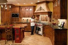 Tuscan kitchen design is not a new trend in interior design world. We can give tips about Tuscan kitchen colors, appliances, accessories, furniture, and Tuscan Kitchen Design, Interior Design Kitchen, Kitchen Designs, Custom Kitchen Cabinets, Custom Kitchens, Wooden Kitchen, Kitchen Paint, Oak Cabinets, Kitchen Backsplash