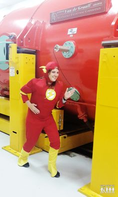 """Team OnCrack had an actual team member, dressed in an actual """"Flash"""" costume, pose beside an actual Hadron Collider!!! How epic is that??!! Team OnCrack, Gishwhes 2013!!"""