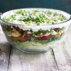 I grew up eating seven layer salads, made by my mom who would whip them up anytime we had a cookout or party at our house. They're always a hit and make for quite a stunning presentation. But...
