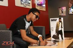 Autographing posters for fans