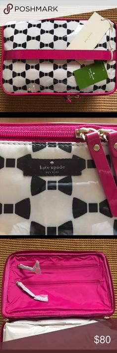 Kate Spade Large Colin Makeup Bag Beautiful makeup/cosmetic bag that will literally fit anything and everything you need. Perfect for traveling or keeping all your makeup and accessories in the same place. Black bow detail with pink trim. This is a two-piece bag: large one and a smaller one inside. Don't miss out on such an amazing cosmetic bag! kate spade Bags Cosmetic Bags & Cases