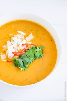 Thai Pumpkin Soup recipe - this delicious soup is the ultimate comfort food. Serve with a swirl of coconut milk and topped with coriander (cilantro) | Find the recipe at DeliciousEveryday.com