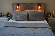 Rustic Headboard with built in lighting on Etsy, $100.00 gonna make a new headboard w old doors and mason jar lights, but the lights shld not be right over your head!
