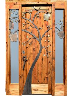Nice rustic front door with metal apple tree decoration
